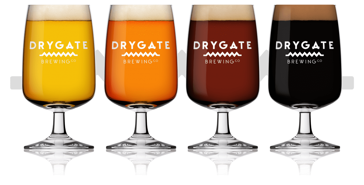 Four schooner glasses with different coloured beers.